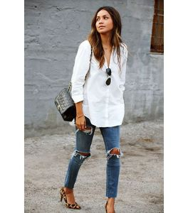 women wearing white shirt, ripped jeans, with leopard heels