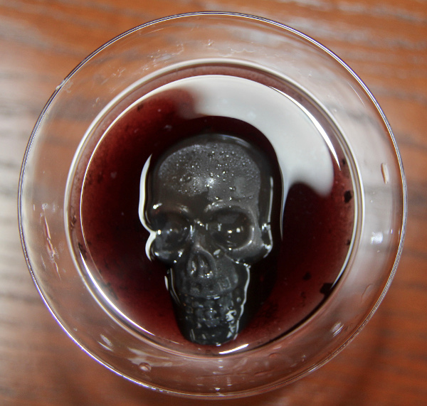 Red Martini Drink with Black Skull Icecube